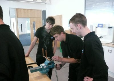 Apprentices go hands-on in a pipe systems workshop at Geberit UK in Warwick