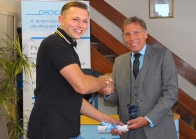 Choice Training Director Robert Maw presents the Choice Plumbing Apprentice of the Year award to Davis Peck